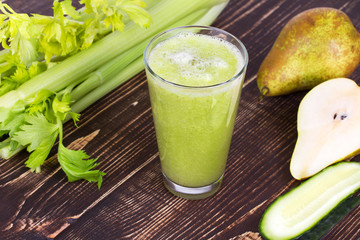 Cucumber, pear and celery juice. Slices of fruits and vegetables