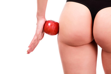 Female shapes and red apple