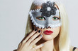 Beautiful Blond Woman in Mask.Young Girl with red lips.Manicure