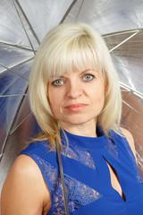A blonde with an umbrella