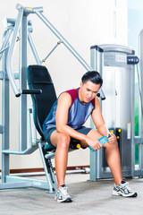 Asian man in gym at training break