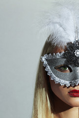 Beautiful Blond Woman in Carnival Mask.Girl.Holiday
