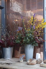 scenery sidewalk cafe. Bouquets of flowers and bread