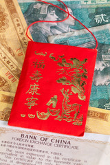 Typical China red envelope and different banknotes