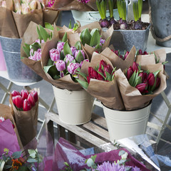 bouquets of colorful spring flowers. tulip, ranunculus, hyacinth