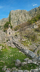 medieval chapel in mountains vertical panorama