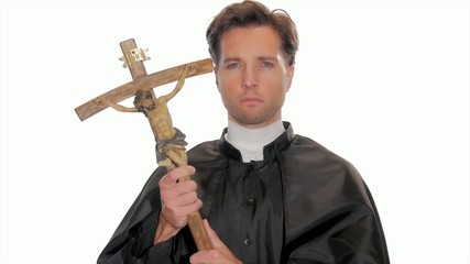 proud young priest holding a crucifix