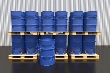 Metal barrels of fuel on a pallet are in the industrial warehous