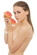 Young nude woman holding grapefruits