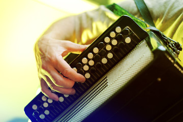 Image of musician playing on accordion closeup