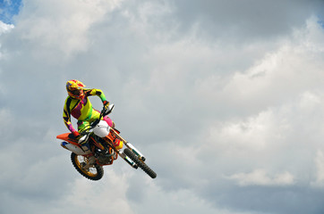 MX rider on a motorcycle in the air