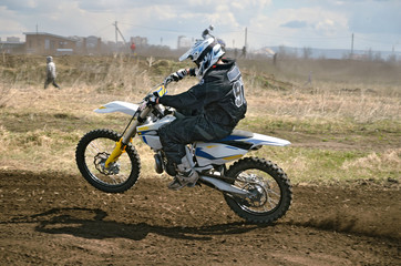 MX rider on a motorcycle in a bend