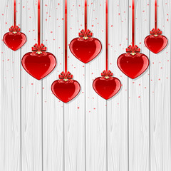 Valentines hearts on wooden background