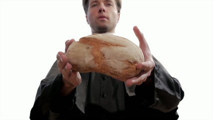 young catholic priest breaking bread