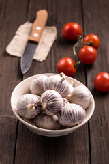 Chinese solo garlic on brown wooden background