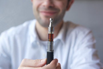 Close up man holding electric cigarette
