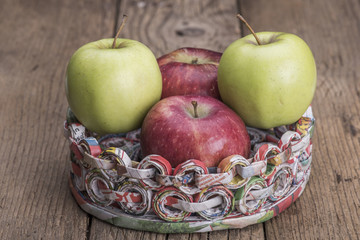 Apples on a support made of recycled paper