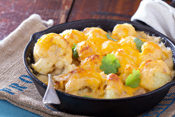 Cauliflower with cheese baked in a pan