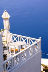 Coffee time on terrace in Santorini island, Greece