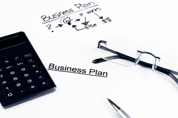 business plan words near glasses, calculator and pen