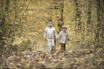 Children playing in a forest
