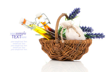 Spa wicker basket with massage oil, isolated on white background