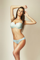 attractive brunette slim girl in lingerie