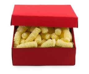 Corn sticks in a box isolated on white background