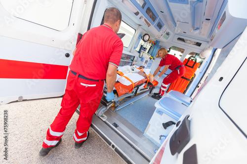 Leinwanddruck Bild Rescue Team Providing First Aid