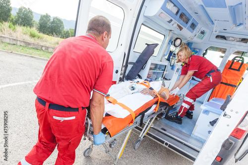 Rescue Team Providing First Aid - 75908295
