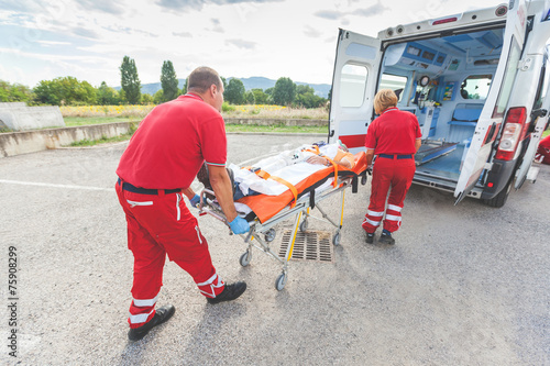 Rescue Team Providing First Aid - 75908299