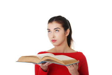 Portrait of student woman holding an open book