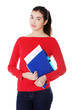 Pretty female student holding her notes