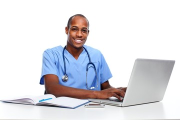 Medical doctor working with computer.