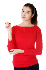 Portrait of a student woman holding pen