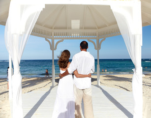 Loving couple in belvedere on the beach