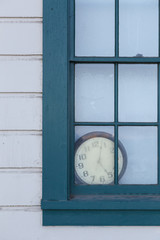 Old Clock behind Window