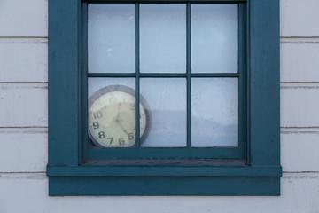 Old Clock behind Window