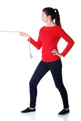 Full length strong woman puling rope