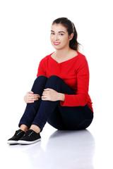Attractive caucasian woman sitting on the floor