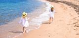 Fototapety Adorable cute girls have fun on white beach during vacation