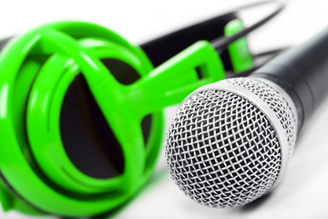 Microphone and green headphones