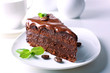 Delicious chocolate cake on plate on table on light background - 75911413