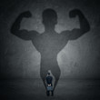 Businessman and strong shadow 1