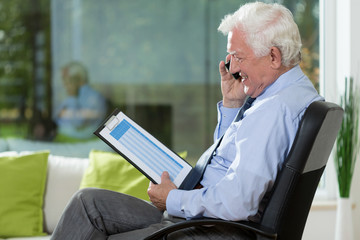 Elderly businessman working at home