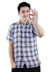 Caucasian man gesturing OK sign