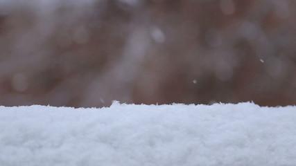 Snowflakes falling on snowdrift and immediately melt