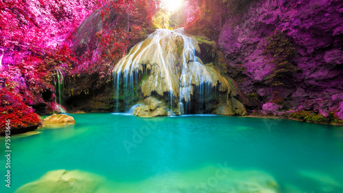 Leinwanddruck Bild wonderful waterfall with colorful tree in thailand