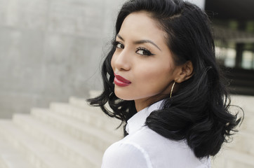 Beautiful elegant young woman turning head