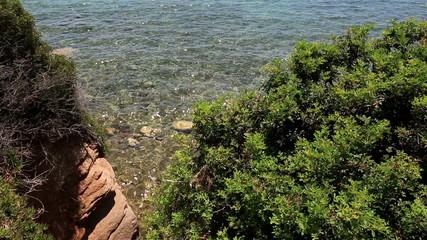 Aegean Sea washes the coast.